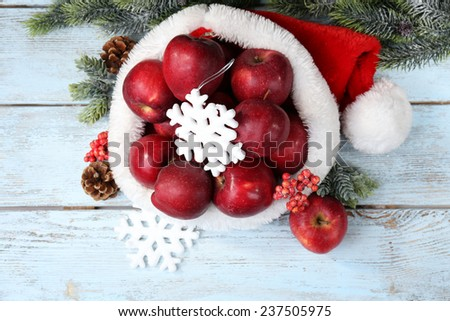 Christmas apples on wooden table - stock photo