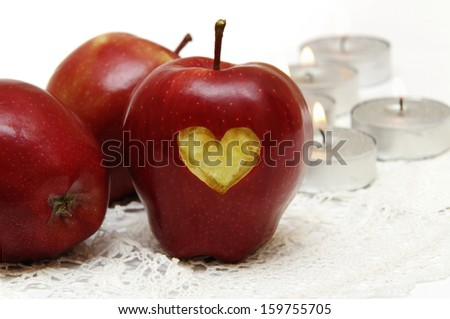 Christmas apples with heart and candles isolated on white