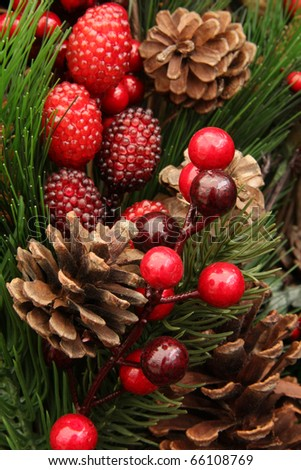 Christmas arrangement including pinecones, greenery and berries. - stock photo