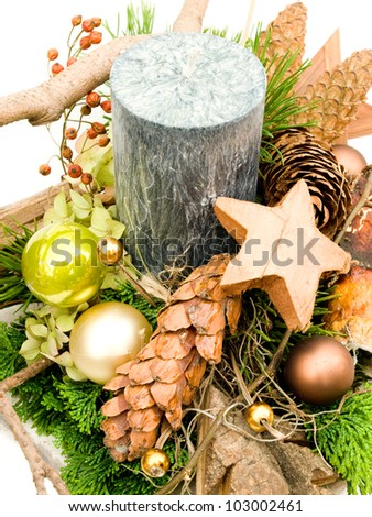 Christmas arrangement with moss, cones, christmas decoration and big candle on white background - stock photo