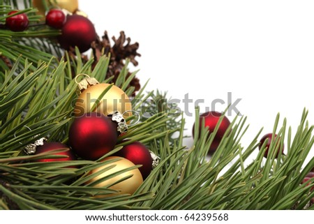 Christmas arrangement with red and gold ornaments isolated on white background. Shallow dof - stock photo