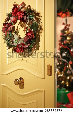 Christmas at home with a door opened - stock photo