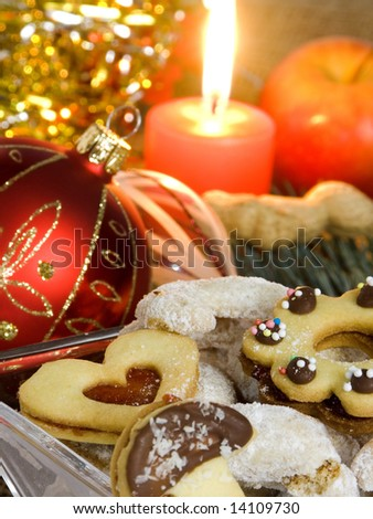 Christmas atmosphere - candle, sweets and Christmas decorations - stock photo