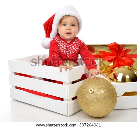 Christmas baby child in santa hat hold gold ball decoration near present gift box. New Year 2016 holiday concept isolated on a white background - stock photo