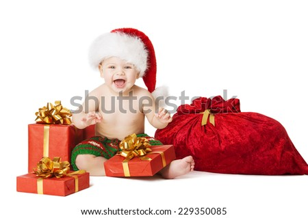 Christmas Baby Kids, Present Gift Box And Santa Bag, Child Happy Smiling In Red Hat With Xmas Sackful, Isolated White Background - stock photo