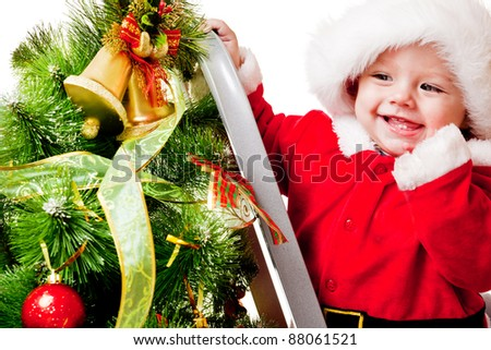 Christmas baby on the step ladder - stock photo