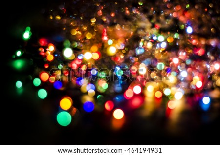 Christmas background. Abstract background with multi-colored highlights and garlands.