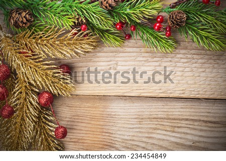 Christmas background and decorations over wooden table - stock photo