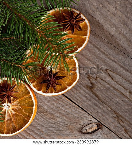 Christmas background and spices, anise, dried orange - stock photo