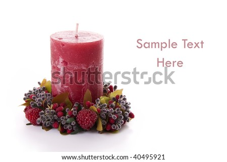 Christmas Background - Beautiful red candle isolated on white - stock photo
