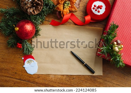Christmas background: blank old paper sheer, pen and decorations - stock photo