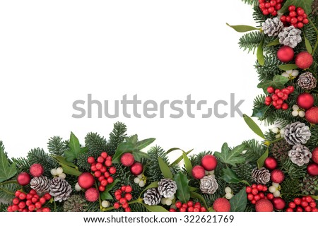 Christmas background border with bauble decorations, holly, ivy, mistletoe, pine cones and blue spruce fir over white. - stock photo
