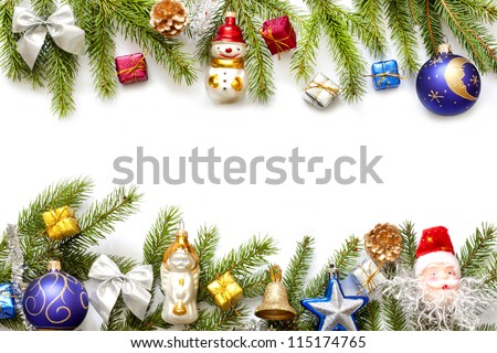 Christmas background border with fir and baubles on white - stock photo