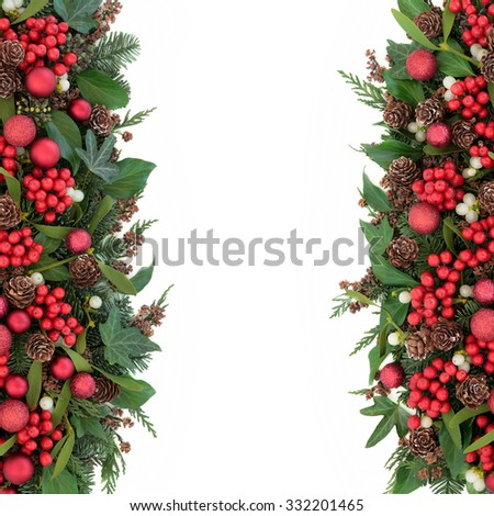 Christmas background border with red bauble decorations, holly, mistletoe, ivy, fir, pine cones and traditional winter greenery over white. - stock photo