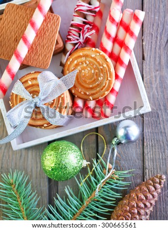 christmas background, christmas cookies and decoration on wooden boards - stock photo