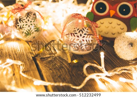 Christmas background. Christmas decoration on wooden table with christmas lights.