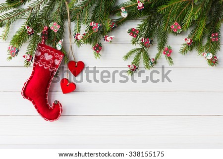 Christmas background. Christmas fir tree with decoration with red hearts on white wooden board background with copy space - stock photo