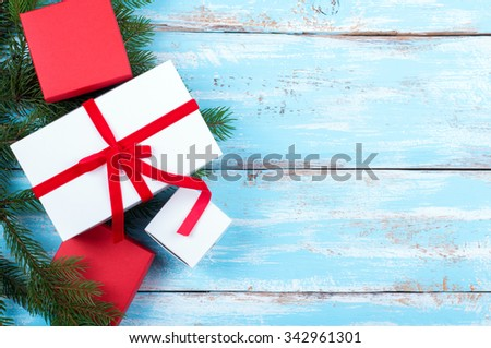 Christmas background. Christmas presents and decorations on wooden board. Copy space. Top view - stock photo