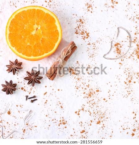 Christmas background. Cinnamon rolls and powder - orange slices - stock photo
