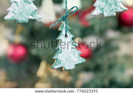 Christmas background - cookies and branch of spruce tree