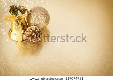 christmas background design on a shiny gold colored surface with reflection