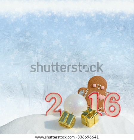 Christmas background. Figure 2016, Christmas balls, gifts and gingerbread man on a festive background - stock photo