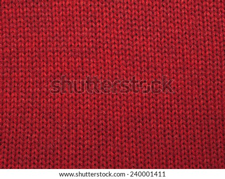 Christmas background from red knitted red wool closeup - stock photo