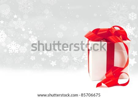 Christmas background - gift box on a snowy background - stock photo