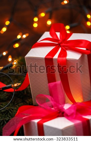 Christmas background. Gift boxes and christmas lights