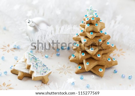 Christmas background. Ginger and Honey Fir tree with white decoration and blue beads - stock photo