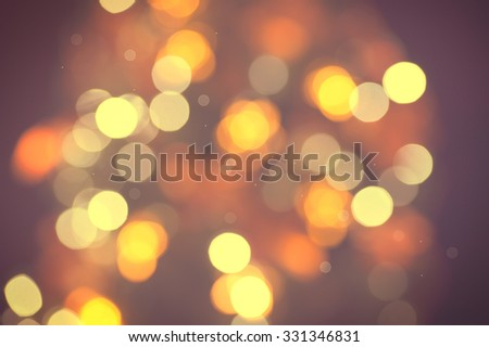 Christmas Background. Golden and brown Holiday glowing Abstract Glitter Defocused Background With Blinking Stars. Blurred Bokeh, vintage toned photo - stock photo