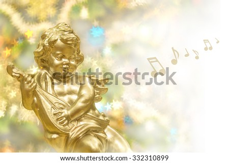 Christmas background, golden angel with music instrument - stock photo