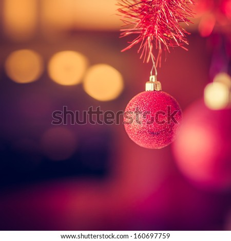 Christmas Background Made of a Red Ball and Beautiful Bokeh - stock photo