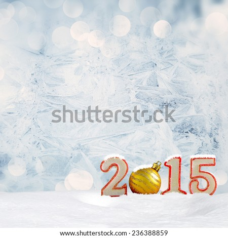 Christmas background - New year 2015 sign with snowdrift and frost patterns on window - stock photo