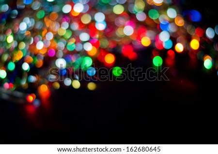 Christmas background of glare. Christmas garland - stock photo