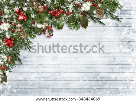 Christmas background of holly, mistletoe, cones, fir branches on - stock photo