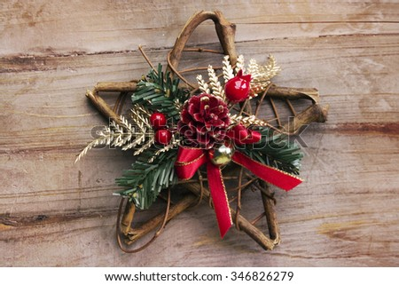 Christmas background, rustic star on wood - stock photo