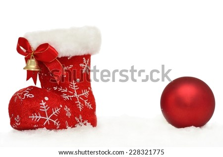 Christmas background Santa's red boot with a bauble in snow on white - stock photo