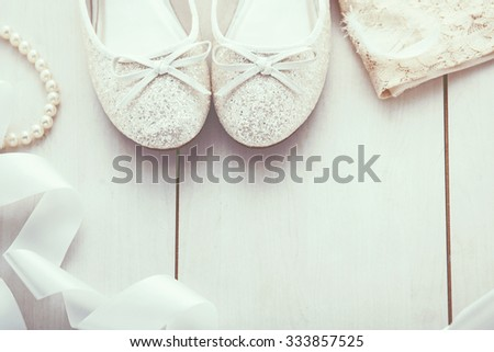 Christmas background: silver glitter shoes and gold dress, holiday decoration, top view - stock photo