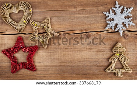 Christmas background. Snowflakes border on grunge wooden board. Winter holidays concept