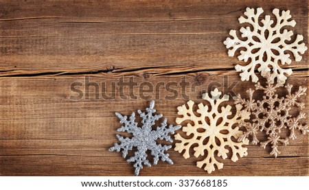Christmas background. Snowflakes border on grunge wooden board. Winter holidays concept - stock photo