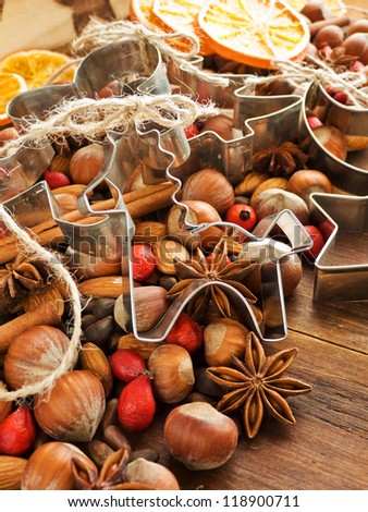 Christmas background spices, dried oranges, and cookie cutters. Shallow dof. - stock photo