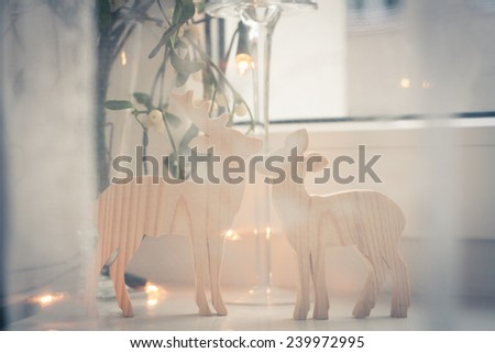 Christmas background: window decorations seen through the curtain - stock photo