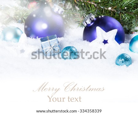 Christmas background with a blue balls, ornament on snow, Holiday decoration