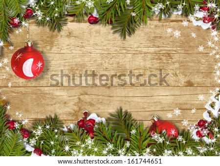 Christmas background with a border of fir branches, ball and hol