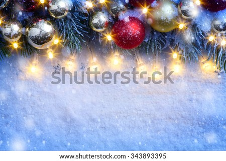 Christmas background with a christmas ornament and fir in snow  - stock photo