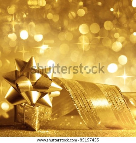 Christmas background with a gift in gold