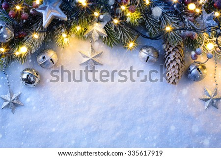 Christmas background with a silver ornament, christmas stars, berries and fir in snow  - stock photo