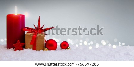 Christmas background with Advent candle and gift box isolated .