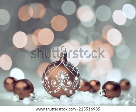 Christmas background with baubles and Christmas lights, shallow DOF, focus on the ball - stock photo